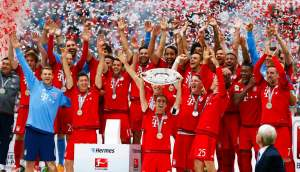 Philip Lahm lifts the trophy