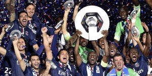 Paris Saint-Germain lift the trophy.  AFP PHOTO / FRANCK FIFE